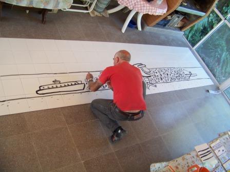 Burone Risso trabaja en un Mural para Tigre