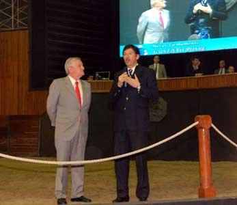 Gustavo Posse hablando junto a Juan Carlos Bagó.